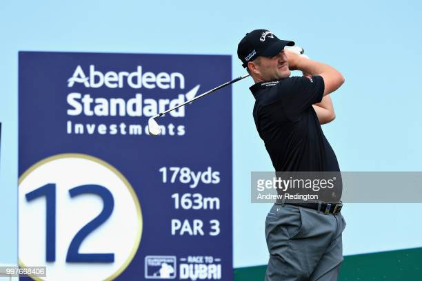 Marc Warren of Scotland takes his tee shot on hole twelve during day two of the Aberdeen Standard Investments Scottish Open at Gullane Golf Course on...