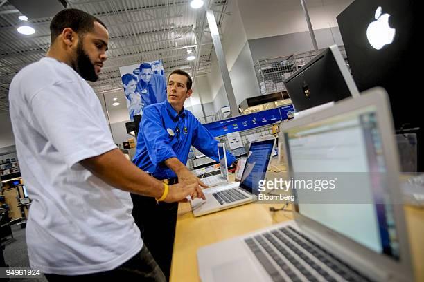 Marc White left asks Best Buy employee Steve Buckner questions about an Apple MacBook Pro laptop computer at a Best Buy store in Atlanta Georgia US...