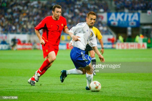 Marc Wilmots of Belgium and Hidetoshi Nakata of Japan during the World Cup match between Japan and Belgium in Saitama Stadium in Saitama Japan on...