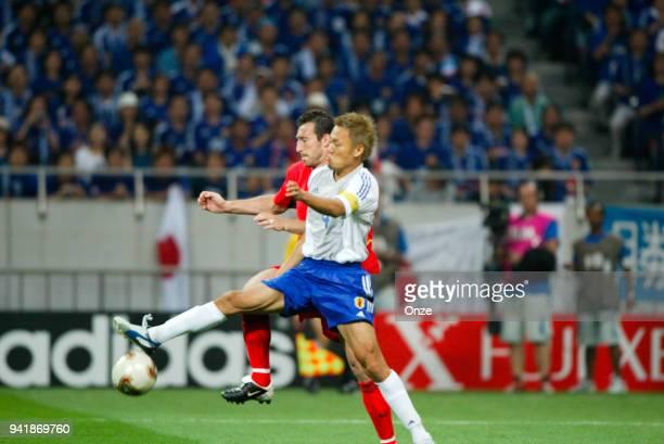 Marc Wilmots of Belgium and Ryuzo Morioka of Japan during the World Cup match between Japan and Belgium on 4th June 2002 at Saitama Stadium 2002...