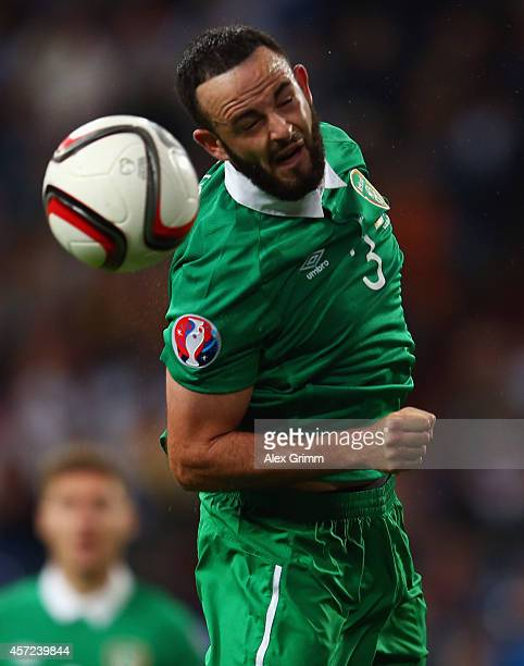 Marc Wilson of Ireland jumps for a header during the EURO 2016 Qualifier between Germany and Republic of Ireland at the VeltinsArena on October 14...