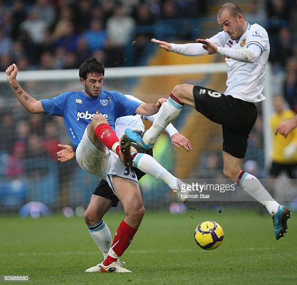 Marc Wilson of Portsmouth contests with Steven Fletcher of Burnley during the Barclays Premier League match between Portsmouth and Burnley at Fratton...