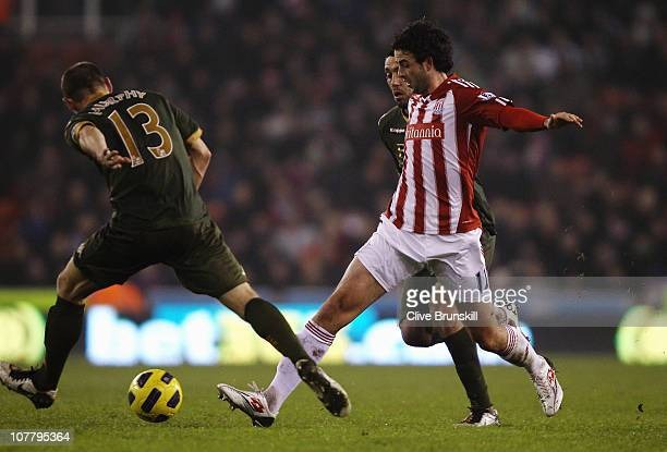 Marc Wilson of Stoke City attempts to pass the ball past Danny Murphy of Fulham during the Barclays Premier League match between Stoke City and...