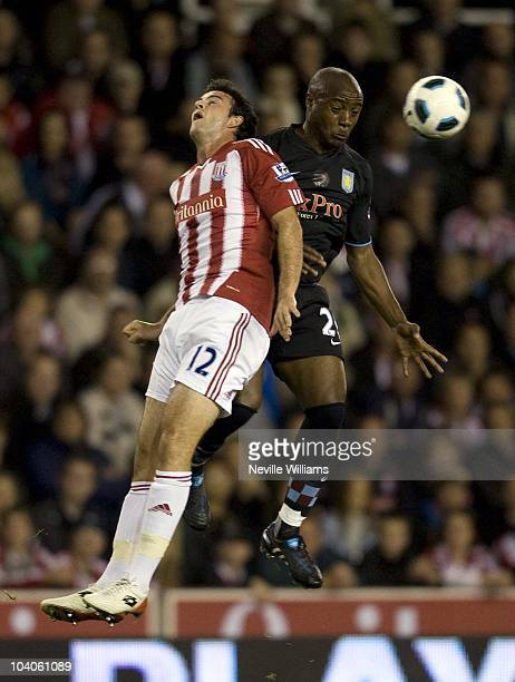 Marc Wilson of Stoke City competes for the ball with Nigel Reo Coker of Aston Villa during the Barclays Premier League match between Stoke City and...