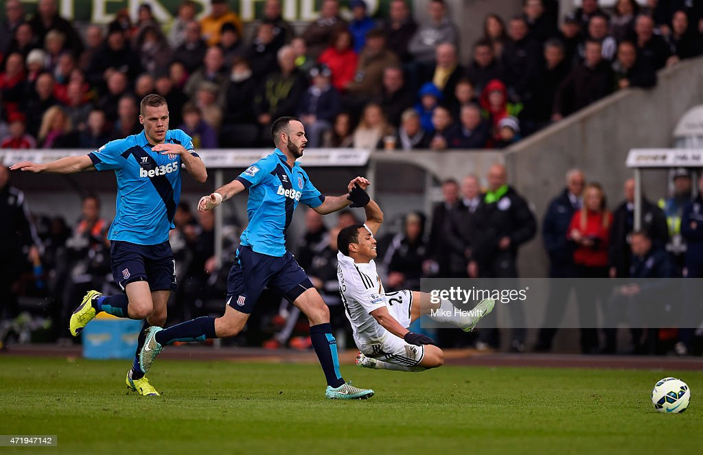 Marc Wilson of Stoke City fouls Jefferson Montero of Swansea City leading to his sending off during the Barclays Premier League match between Swansea City and Stoke City at Liberty Stadium on May 2, 2015 in Swansea, Wales.