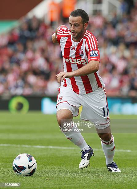 Marc Wilson of Stoke City runs with the ball during the Barclays Premier League match between Stoke City and Arsenal at the Britannia Stadium on...