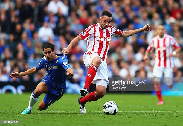 Marc Wilson of Stoke City tangles with Eden Hazard of Chelsea during the Barclays Premier League match between Chelsea and Stoke City at Stamford...