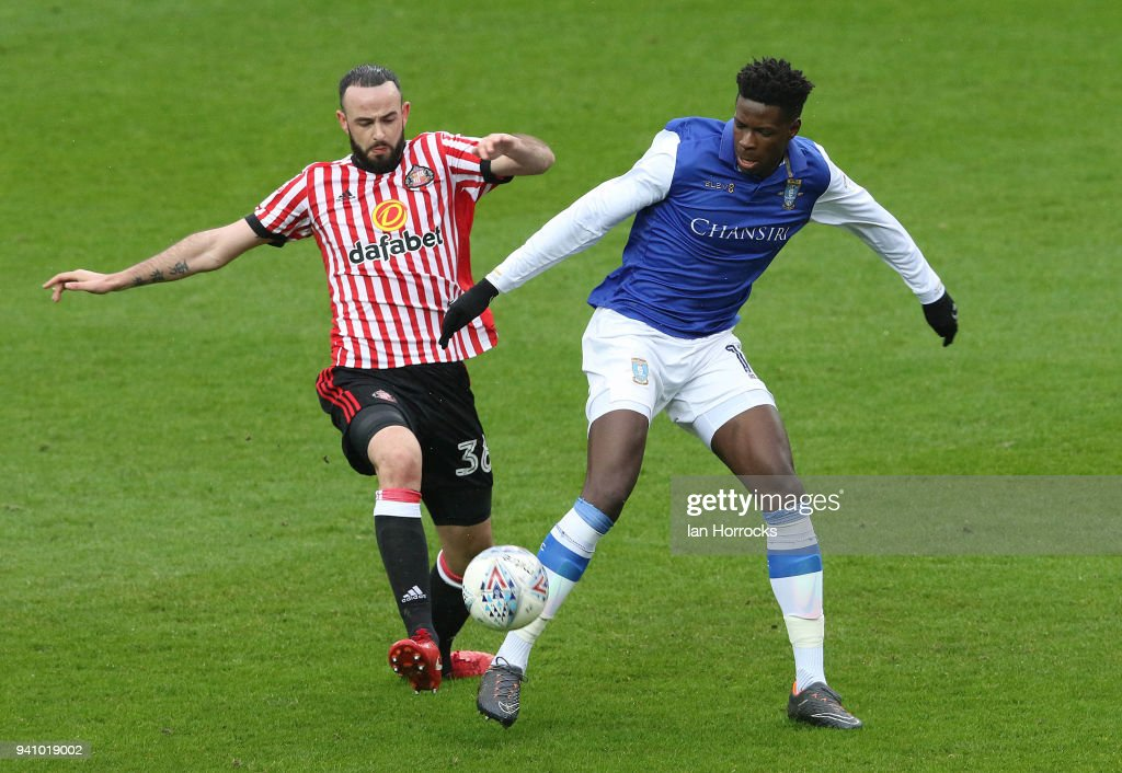 Marc Wilson of Sunderland challenges Lucas Joao of Sheffield (R) during the Sky Bet Championship match between Sunderland AFC and Sheffield Wednesday FC at Stadium of Light on April 2, 2018 in Sunderland, England.