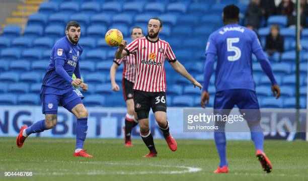 Marc Wilson of Sunderland clears from Callum Paterson of Cardiff during the Sky Bet Championship match between Cardiff City and Sunderland at Cardiff...