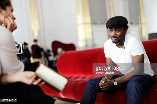 Marc Zinga speaks with journalist during 32nd Namur International FrenchLanguage Film on October 5 2017 in Namur Belgium