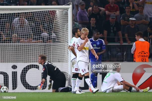 MarcAndré ter Stegen Tolga Cigerci Mike Hanke and Luuk de Jong of Moenchengladbach look dejected after the third goal of Kiew during the UEFA...