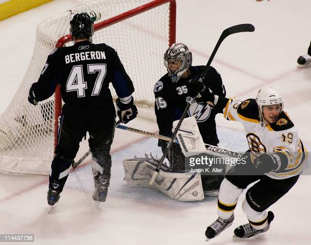 Marc-Andre Bergeron and Dwayne Roloson of the Tampa Bay Lightning react as Tyler Seguin of the Boston Bruins scores a third period goal in Game Three...