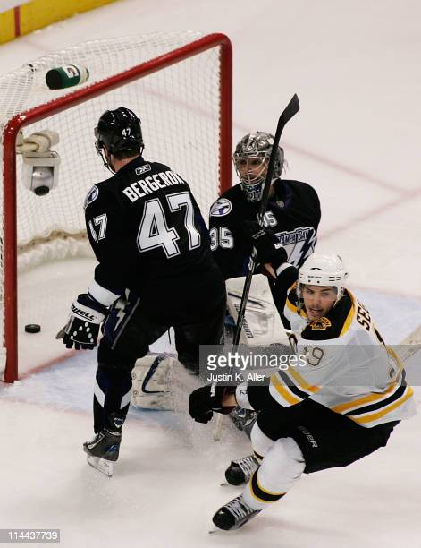 MarcAndre Bergeron and Dwayne Roloson of the Tampa Bay Lightning react as Tyler Seguin of the Boston Bruins scores a third period goal in Game Three...