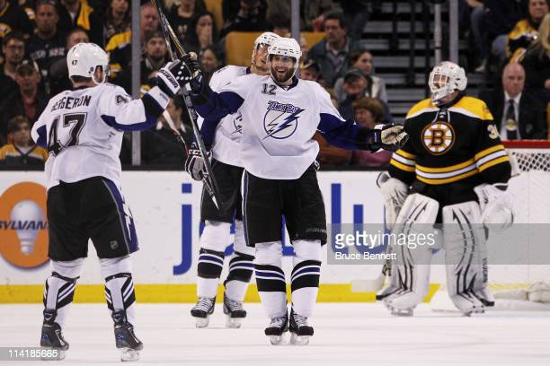 MarcAndre Bergeron celebrates his third period powerplay goal with Simon Gagne of the Tampa Bay Lightning during Game One of the Eastern Conference...
