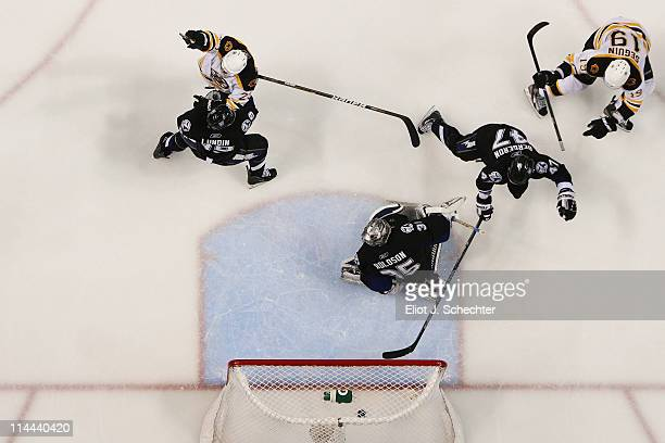 MarcAndre Bergeron Dwayne Roloson of the Tampa Bay Lightning and Chris Kelly of the Boston Bruins react as Tyler Seguin of the Boston Bruins scores a...