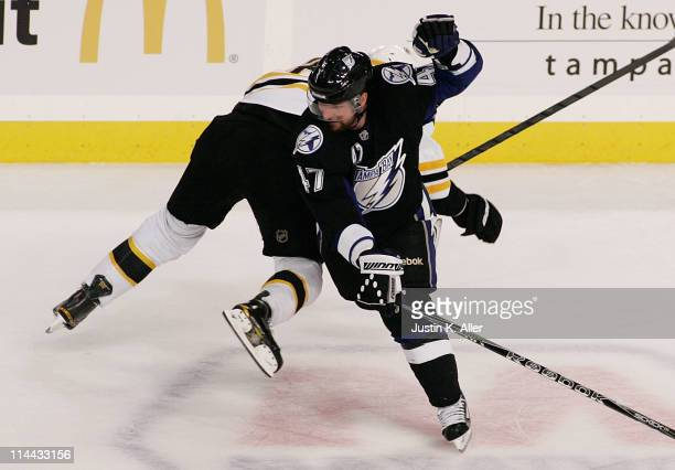 MarcAndre Bergeron of the Tampa Bay Lightning is called for an eblowing penalty against David Krejci of the Boston Bruins in the first period of Game...