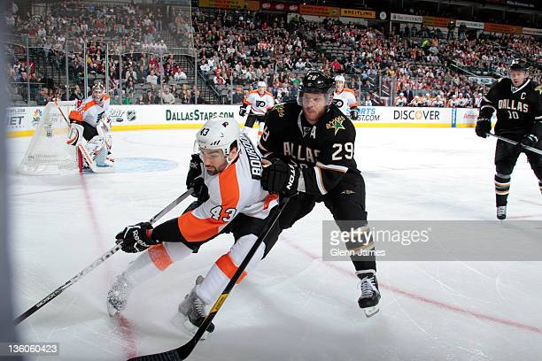 Marc-Andre Bourdon of the Philadelphia Flyers tries to keep the puck away against Steve Ott of the Dallas Stars at the American Airlines Center on...