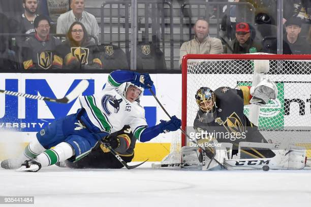 MarcAndre Fleury and Brayden McNabb of the Vegas Golden Knights defend their goal against Bo Horvat of the Vancouver Canucks during the game at...