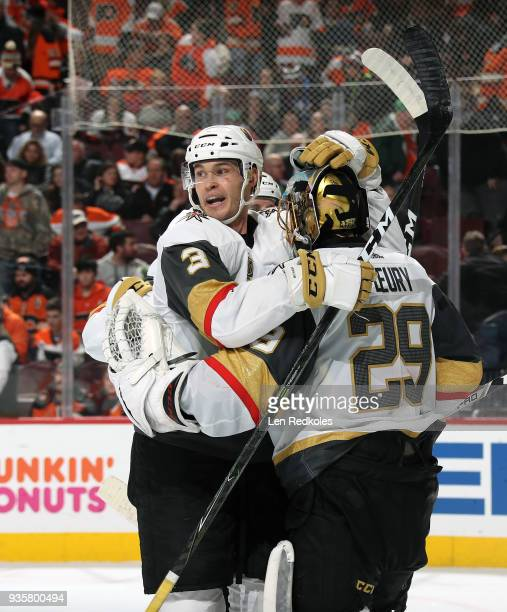 MarcAndre Fleury and Brayden McNabb of the Vegas Golden Knights celebrate after defeating the Philadelphia Flyers 32 on March 12 2018 at the Wells...