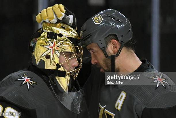 Marc-Andre Fleury and Deryk Engelland of the Vegas Golden Knights celebrate on the ice after the team's 6-2 victory over the Calgary Flames at...
