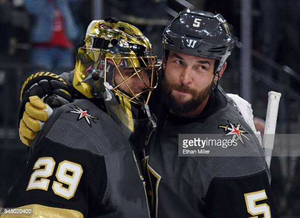 Marc-Andre Fleury and Deryk Engelland of the Vegas Golden Knights celebrate after the team's 1-0 win over the Los Angeles Kings in Game One of the...