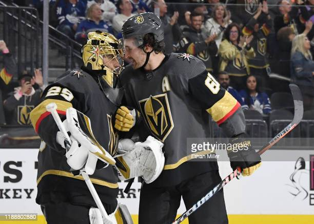 MarcAndre Fleury and Mark Stone of the Vegas Golden Knights celebrate after Stone scored a thirdperiod powerplay goal against the Toronto Maple Leafs...
