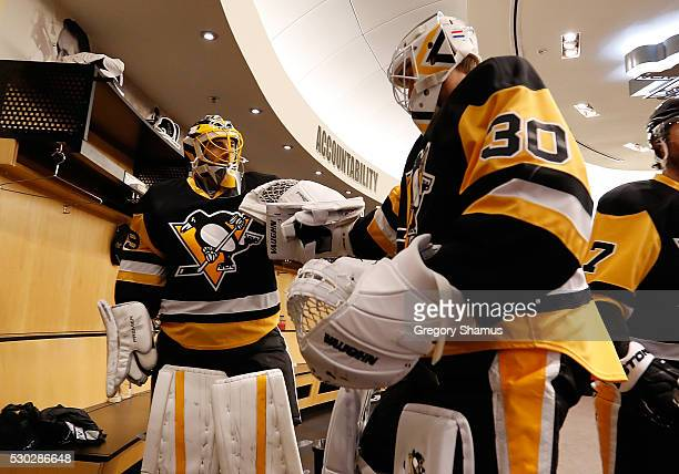 MarcAndre Fleury and Matt Murray of the Pittsburgh Penguins prepare for warmups prior to the game against the Washington Capitals in Game Six of the...