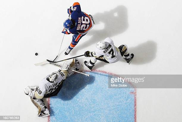 Marc-Andre Fleury and Paul Martin of the Pittsburgh Penguins defend the net against Matt Moulson of the New York Islanders at Nassau Veterans...