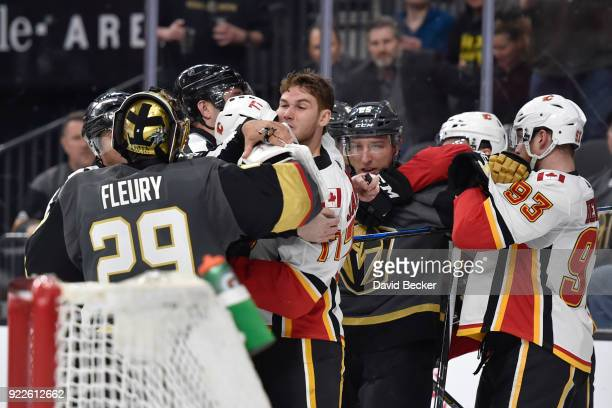 MarcAndre Fleury and Stefan Matteau of the Vegas Golden Knights get into a scrum with Mark Jankowski and Sam Bennett of the Calgary Flames during the...