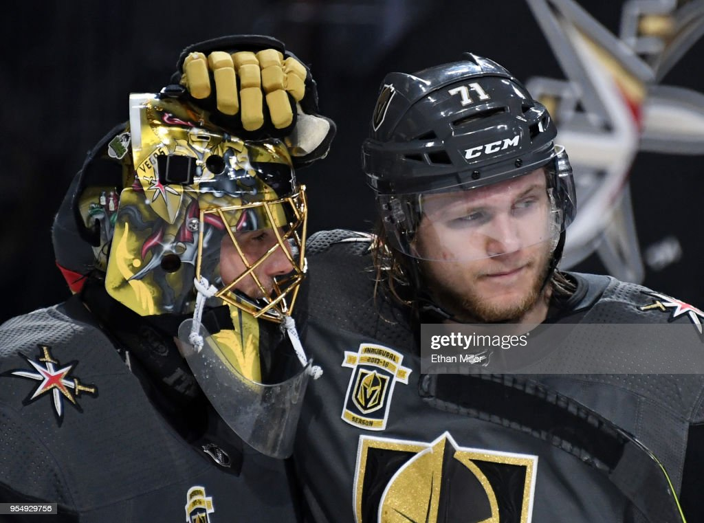 Marc-Andre Fleury #29 and William Karlsson #71 of the Vegas Golden Knights celebrate after beating the San Jose Sharks 5-3 in Game Five of the Western Conference Second Round during 2018 NHL Stanley Cup Playoffs at T-Mobile Arena on May 4, 2018 in Las Vegas, Nevada.