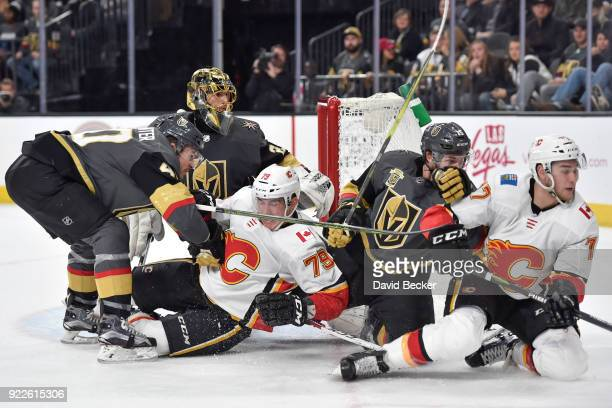 MarcAndre Fleury defends his goal while his teammates Ryan Carpenter and Jon Merrill of the Vegas Golden Knights skate to the puck against Micheal...