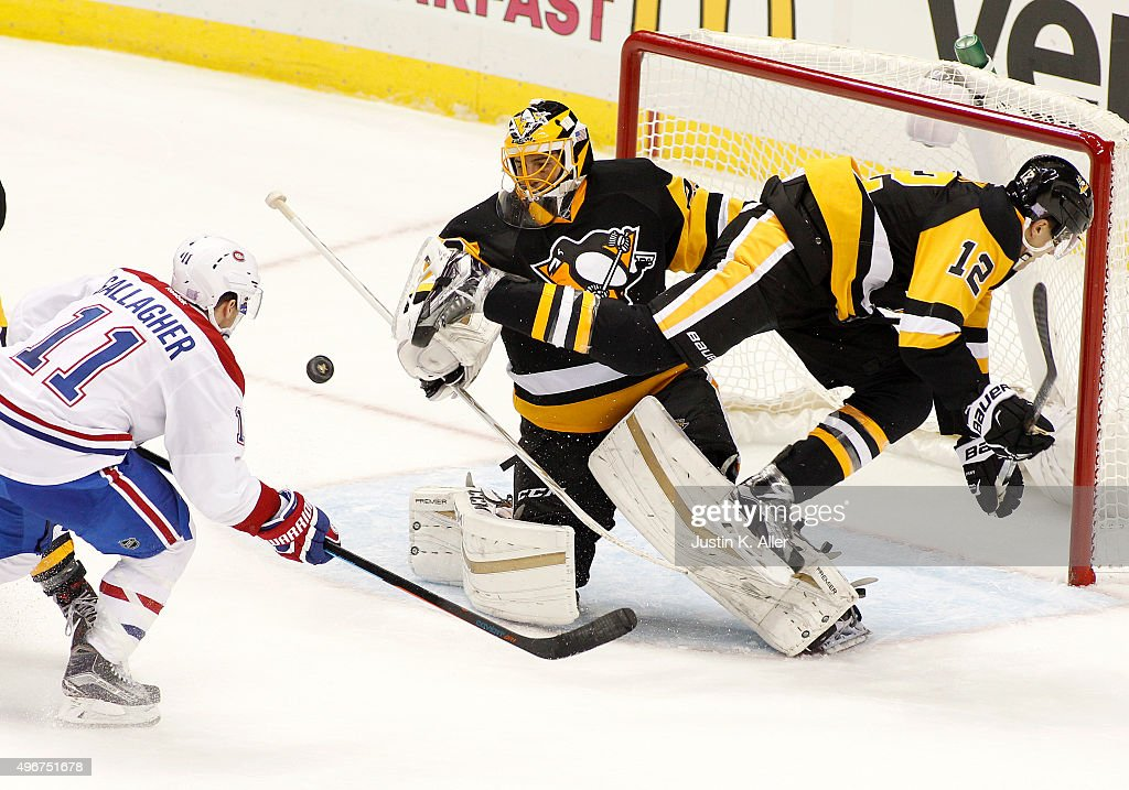 Marc-Andre Fleury #29 of the Pittsburgh Penguins and defenseman Ben Lovejoy #12 defend against Brendan Gallagher #11 of the Montreal Canadiens at Consol Energy Center on November 11, 2015 in Pittsburgh, Pennsylvania.