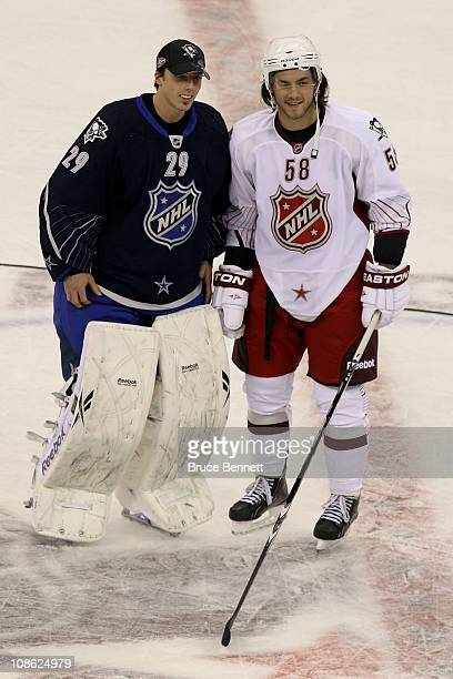 MarcAndre Fleury of the Pittsburgh Penguins and Kris Letang of the Pittsburgh Penguins pose for a photo after Team Lidstrom defeated Team Staal 11 to...