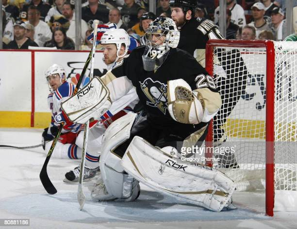MarcAndre Fleury of the Pittsburgh Penguins battles for position with Blair Betts of the New York Rangers in game two of the 2008 NHL Eastern...
