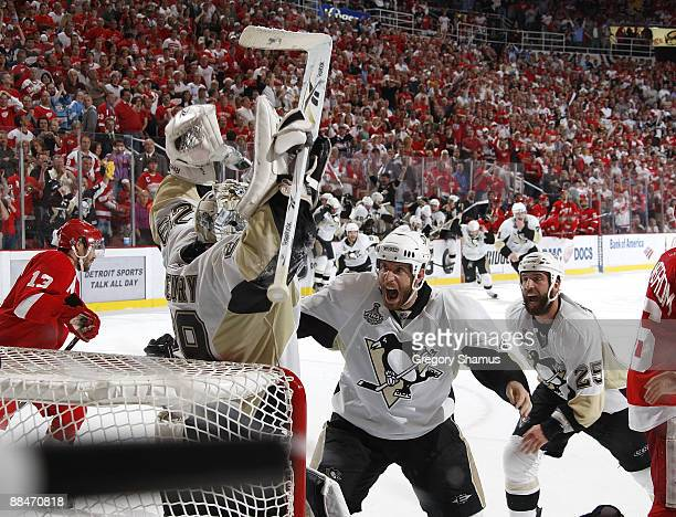 MarcAndre Fleury of the Pittsburgh Penguins celebrates with teammates Rob Scuderi and Maxime Talbot as time expires to win the 2009 Stanley Cup by...