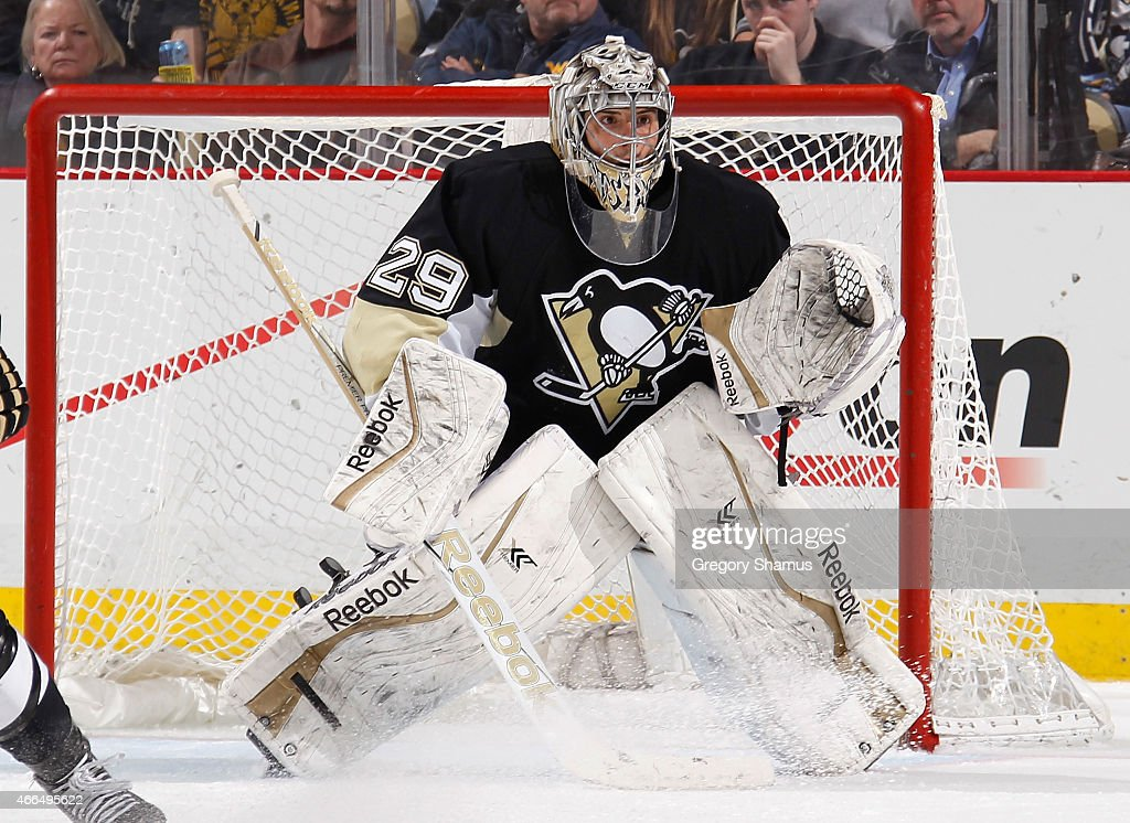 Marc-Andre Fleury #29 of the Pittsburgh Penguins defends the net against the Edmonton Oilers at Consol Energy Center on March 12, 2015 in Pittsburgh, Pennsylvania.