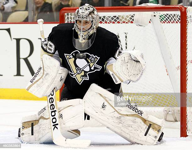 Marc-Andre Fleury of the Pittsburgh Penguins eyes the puck against the Calgary Flames during the game at Consol Energy Center on December 12, 2014 in...