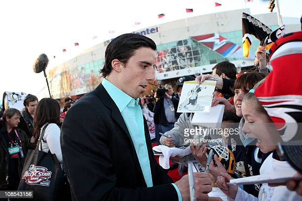 MarcAndre Fleury of the Pittsburgh Penguins for team Lidstrom signs autogrpahs for fans at the Red Carpet Arrivals part of the 2011 NHL AllStar...