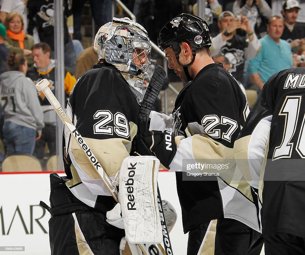 Marc-Andre Fleury #29 of the Pittsburgh Penguins is congratulated by Craig Adams #27 after a 6-4 win over the Montreal Canadiens on April17, 2013 at Consol Energy Center in Pittsburgh, Pennsylvania.