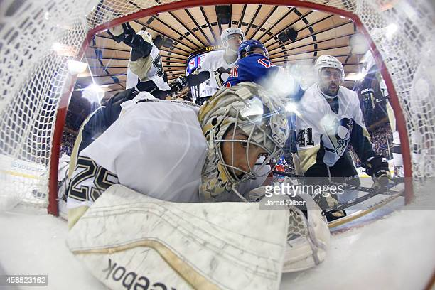 MarcAndre Fleury of the Pittsburgh Penguins is knocked into the net during a pile up in the crease against the New York Rangers at Madison Square...