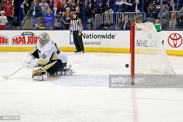 MarcAndre Fleury of the Pittsburgh Penguins is unable to stop a shot from Nick Foligno of the Columbus Blue Jackets during the overtime period in...