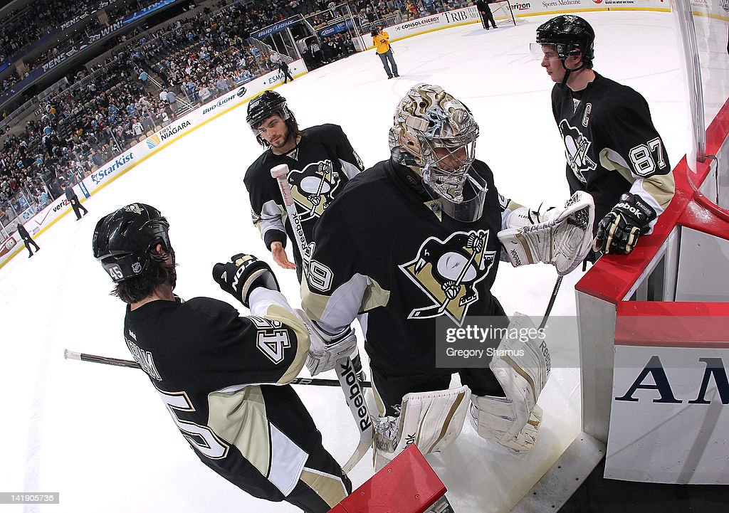 Marc-Andre Fleury #29 of the Pittsburgh Penguins leaves the ice after a 5-2 win over the New Jersey Devils on March 25, 2012 at Consol Energy Center in Pittsburgh, Pennsylvania.
