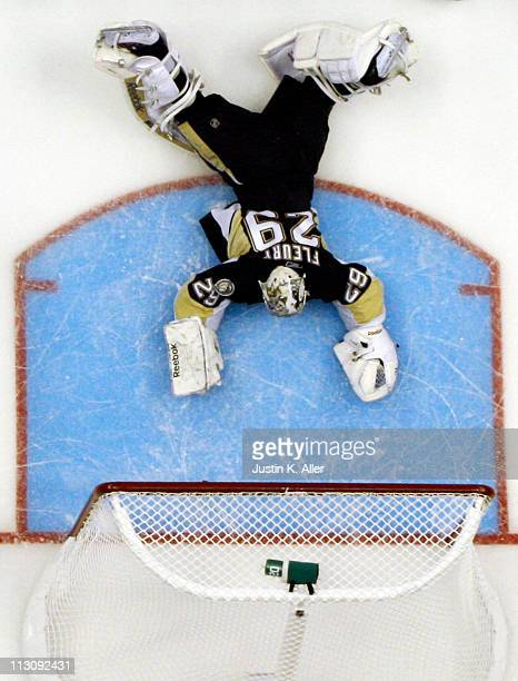 MarcAndre Fleury of the Pittsburgh Penguins lies dejected after giving up a goal against the Tampa Bay Lightning in Game Five of the Eastern...