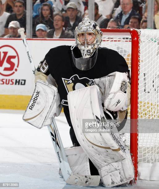 Marc-Andre Fleury of the Pittsburgh Penguins looks up ice against the Carolina Hurricanes during Game One of the Eastern Conference Finals of the...