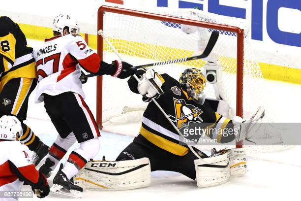 MarcAndre Fleury of the Pittsburgh Penguins makes a glove save against the Ottawa Senators during the second period in Game One of the Eastern...