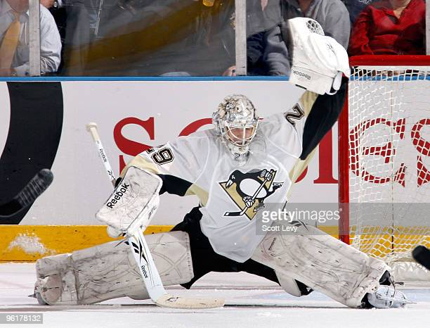 MarcAndre Fleury of the Pittsburgh Penguins makes a glove save against the New York Rangers in the second period on January 25 2010 at Madison Square...