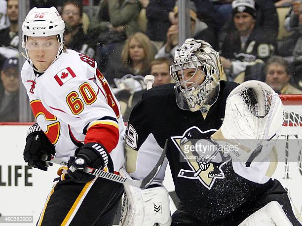 Marc-Andre Fleury of the Pittsburgh Penguins makes a save against Markus Granlund of the Calgary Flames in the second period during the game at...