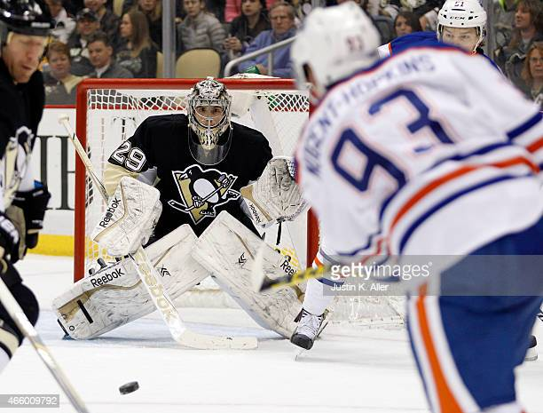 MarcAndre Fleury of the Pittsburgh Penguins makes a save during the game against Ryan NugentHopkins of the Edmonton Oilers at Consol Energy Center on...
