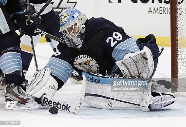 MarcAndre Fleury of the Pittsburgh Penguins makes a save in front of the goal during the game against the Nashville Predators on March 22 2012 at...