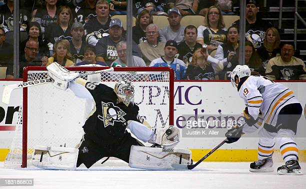 MarcAndre Fleury of the Pittsburgh Penguins makes a save on Cody Hodgson of the Buffalo Sabres during the game at Consol Energy Center on October 5...